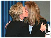 Hillary kissing Arafat's wife.